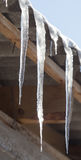 Icicles from the roof of the house Stock Images