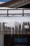 Icicles on the roof of a house Royalty Free Stock Photography