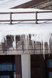 Icicles on the roof of a house Royalty Free Stock Images
