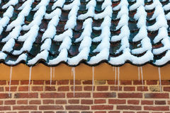 Icicles on the roof of an old Dutch farm Stock Images