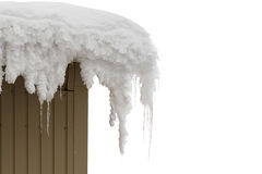 Icicles on the roof in winter. Stock Photos