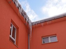 Icicles series on the roof of the house when the warming. Stock Photography