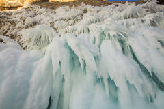 Icicles on the shore of Lake Baikal. Stock Image
