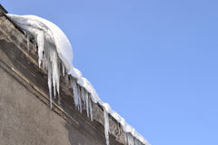 Icicles and snow on the roof. Stock Image