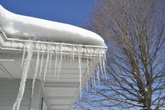 Icicles and snow on roof. Stock Images