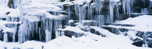Icicles and snowy rocks in Sierra Nevada Mountains, California Royalty Free Stock Photo