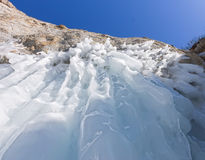 Icicles sokuy hanging over the head with a rock Olkhon Island on Royalty Free Stock Images