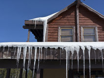 Icicles surrounding a roof Stock Photo