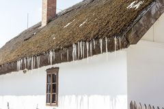 Icicles on a thatch. Of a traditional cottage house in Ocsa, Hungary stock images
