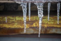 Icicles on vintage roof closeup. Winter weather concept. Froze and ice background. Snow and icicle. Melting icicles. Icicles on vintage roof closeup. Winter royalty free stock photo
