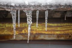 Icicles on vintage roof closeup. Winter weather concept. Froze and ice background. Snow and icicle. Melting icicles. Icicles on vintage roof closeup. Winter royalty free stock photography