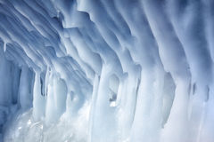 Icicles on the wall of ice cave stock images