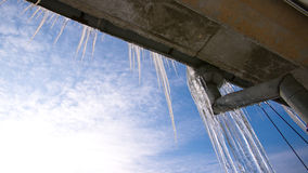 Icicles on the water pipe Stock Photos