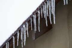 Icicles which are hanging down from a roof Royalty Free Stock Image