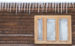 Icicles on the window Stock Photography