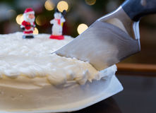 Icing on Christmas cake with tree lights Stock Image