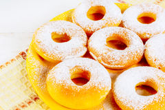 Icing homemade donuts on yellow plate Stock Photo