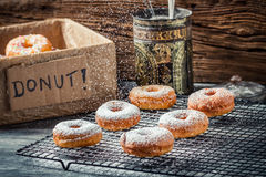 Icing sugar falling on fresh donuts Stock Image