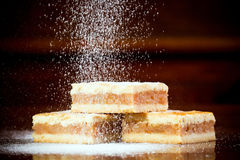 Icing sugar flow. Flowing chocolate drops of from an egg-beater royalty free stock image