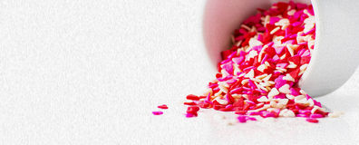 Icing sugar. Shape of hearts. Royalty Free Stock Photos