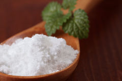 Icing sugar in a wooden spoon Royalty Free Stock Image