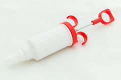 Icing Syringe / Icing Syringe Isolated on White Royalty Free Stock Image