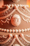 Icing on tiered wedding cake Stock Photography