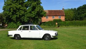 Classic White Rover 2000 Motor Car Parked on Village Green. Stock Photo
