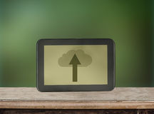 ICloud storage and cloud computing service concept. Digital tablet with illustration depicting iCloud storage and cloud computing service on green background Stock Photos