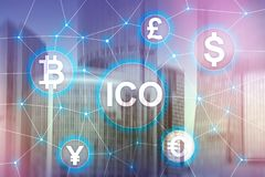 ICO - Initial coin offering, Blockchain and cryptocurrency concept on blurred business building background.  stock photos