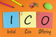 ICO Initial Coin Offering Concept. Initial Coin Offering words with ICO written on color notes with and office supplies. Business concept. Top view Royalty Free Stock Photos