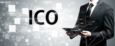 ICO with man holding tablet computer. ICO with man holding a tablet computer stock photography