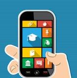 Ico piano della mano di istruzione mobile umana variopinta dei apps Fotografie Stock Libere da Diritti