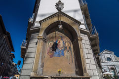 Icon at the corner of building and behind the Basilica, Florence Stock Photos
