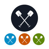Icon of a Crossed Shovels Stock Images