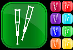 Icon of crutches. Icon of a pair of crutches on shiny buttons Stock Images