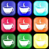 Icon of a cup on buttons. Icon of a cup of hot drink on shiny buttons Stock Photo