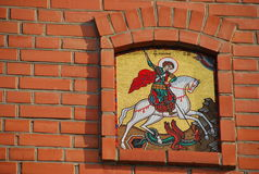 Icon depicting St. George the victorious on a brick wall. Mosaic on the Kremlin wall Stock Photo
