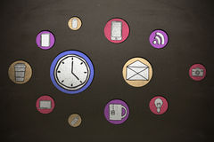 Composite image of icon of device. Icon of device against blackboard Royalty Free Stock Images