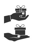 Icon a gift in a hand. On the image  is presented icon a gift in a hand Stock Photo