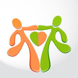 Icon of a happy couple - two humans with heart in the center, design element for your logo Royalty Free Stock Photos