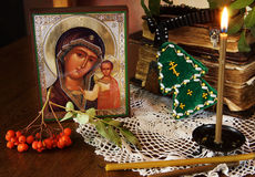 Icon of the Holy Mother and burning candle Stock Photos