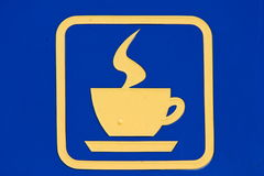 Icon hot coffee. On a blue background depicts an icon of hot coffee Royalty Free Stock Images