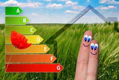 Icon of house energy efficiency rating with cute fingers, poppy and green background. Cute icon of house energy efficiency rating with cute fingers, poppy and Stock Images