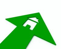 Icon house inside arrow. Icon of a small house inside of a green arrow Stock Photo