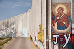 Icon on Israeli separation barrier. An icon of Our Lady Mother of God, Mother of the Church, is painted on the Israeli separation wall in the West Bank town of Royalty Free Stock Photography