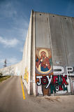 Icon on Israeli separation barrier Stock Photo