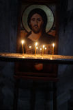 Icon of Jesus and candles Stock Images