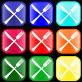 Icon of knife and fork. On shiny buttons Stock Photography
