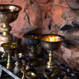 Icon-lamps in tibetan gompa Royalty Free Stock Photography